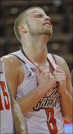 Bowling Green senior Luke Kraus reacts while the band plays after being defeated by Miami.