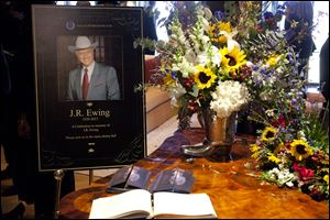 "A funeral scene for the character J.R. Ewing, played by Larry Hagman, in an episode of ""Dallas,"" airing at 9 p.m. today on TNT. Hagman died of cancer at 81 the day after Thanksgiving."