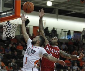 BGSU's Jordon Crawford gets his shot blocked from behind by Miami's Quinten Rollins.