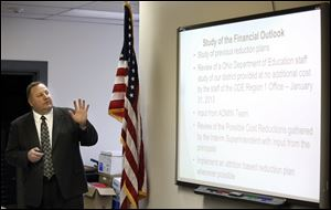 Wauseon Superintendent Larry Brown talks about budget cuts during a school board meeting.