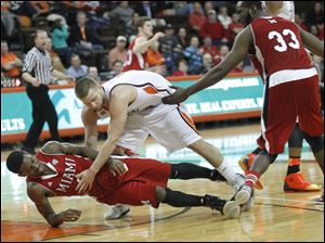 The game gets physical as Miami's Geovonie McKnight is knocked over by BGSU's Luke Kraus.