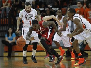 Miami's Geovonie McKnight steals the ball from BGSU.