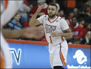 BGSU's Jordon Crawford points to his head after hitting a 3-pointer that put BGSU only 4 points behind Miami with eight minutes left in the game.