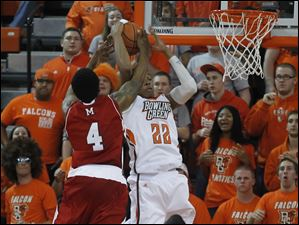 Miami's Reggie Johnson fouls BGSU's Richaun Holmes as Holmes rebounds a Miami missed basket.