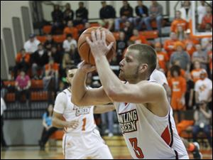 BGSU's Luke Kraus attempts and misses a 3-pointer.