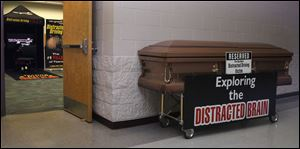 A coffin sits outside the hallway of a classroom where Owens students were given an opportunity to text and drive in a simulator.
