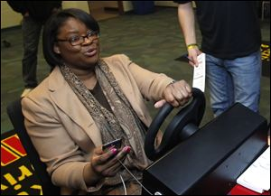 Owens student Kewanna Vessel reacts to hitting a U-Haul while texting and driving while using a simulator.