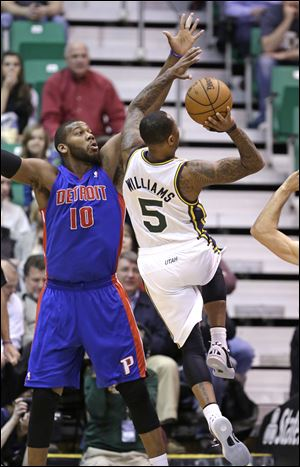 Utah Jazz's Mo Williams (5) shoots as Detroit Pistons' Greg Monroe (10) defends in the first quarter during an NBA basketball game.