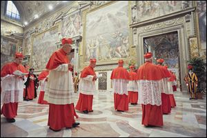 Cardinals enter the Sistine Chapel to begin the conclave that will choose a successor to Benedict XVI, Pope Emeritus. Cardinals from around the globe locked themselves inside the Sistine Chapel on Tuesday to choose a new leader.