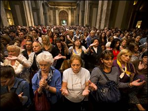 Worshipers pack the Metropolitan Cathedral during the evening Mass on March 13 in Buenos Aires, Argentina.