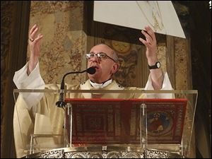 Argentine Cardinal Jorge Bergoglio celebrating a 2005 Mass in honor of late Pope John Paul II, pictured at top, at the Buenos Aires Cathedral in Buenos Aires, Argentina.