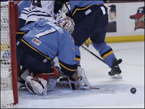 Walleye goalie Jordan Pearce deflects the puck during 2nd period.