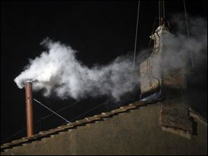 White smoke emerges from the chimney on the roof of the Sistine Chapel, in St. Peter's Square at the Vatican indicatING that the new pope has been elected.