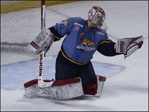 Walleye goalie Jordan Pearce makes a save against Greenville.