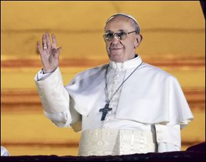 Pope Francis — Cardinal Jorge Bergoglio of Argentina — greets the crowd from the central balcony of St. Peter's Basilica at the Vatican. He is the 266th Pontiff of the Roman Catholic Church.