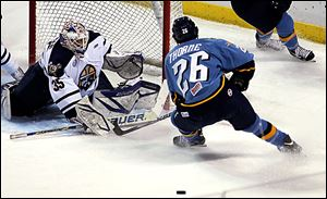 Greenville goalie Scott Stajcer deflects a shot by the Walleye's Stephon Thorne.