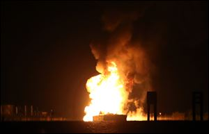 A tugboat and barge are engulfed in flames after hitting a natural gas pipeline in Bayou Perot about two miles south of lower Lafitte, Louisiana, Tuesday.
