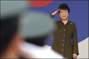 South Korean President Park Geun-hye salutes during a joint commission ceremony of 5,780 new officers of Army, Navy, Air Force and Marines at the Gyeryong military headquarters in Gyeryong, South Korea, last Friday.