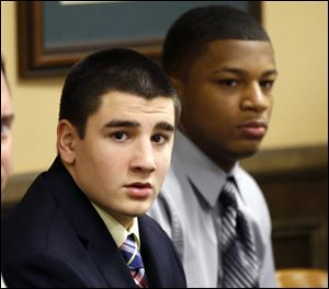 Trent Mays, 17, left, and 16-year-old Ma'lik Richmond sit at the defense table before the start of their trial on rape charges in juvenile court today in Steubenville, Ohio.