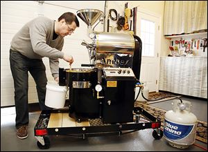 Richard Jambor of the Maddie & Bella Coffee Co. roasts coffee beans in his garage in Perrysburg.