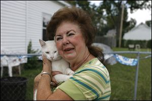 Republican mayoral candidate Opal Covey and her cat Tink at home in Toledo.