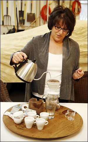 Susan Jambor is the fledgling company's coffee tester.