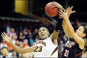 Central Michigan's Crystal Bradford beats Bowling Green's Chrissy Steffen for the rebound.