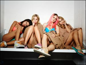 "From left, Selena Gomez, Ashley Benson, Rachel Korine and Vanessa Hudgens in a scene from ""Spring Breakers."""