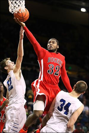 Rogers' DeVonte Pratt, who had 15 points, drives against Anthony Wayne's Jake Reed, left, and Mark Donnal in a Division I regional semifinal. The Rams (19-7) play Brecksville-Broadview in the final.