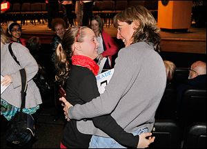 Samantha Schofield of Fallen Timbers Middle School gets a hug from her mother, Janet Schofield, after winning the Blade Northwest Ohio Championship Spelling Bee at Owens Community College.
