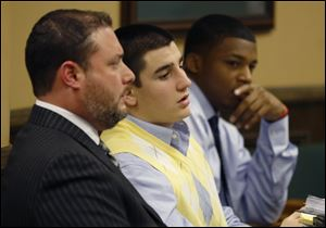 From left, Defense attorney Adam Nemann, his client, defendant Trent Mays, 17, and co-defendant 16-year-old Ma'lik Richmond listen to testimony during Mays and Richmond's trial on rape charges in juvenile court on Thursday in Steubenville.
