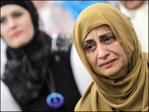 Tears well up in the eyes of Dr. Samina Hasan, Waterville, during Friday prayer services.