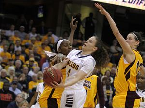 UT's Naama Shafir is guarded by CMU's Brandie Baker.