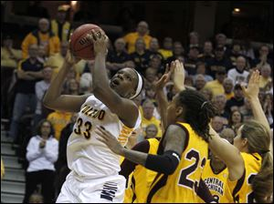 UT's Yolanda Richardson gets past CMU defenders to get the Rockets within one point late in the game.