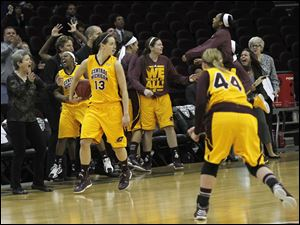 CMU players celebrate their victory.