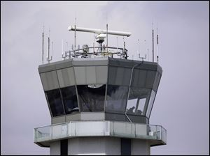 As at the air traffic control tower at Chicago's Midway International Airport, looming federal budget cuts could mean the closure of nearly 240 air traffic control towers at small airports across the country.