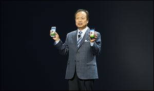 JK Shin, President and Head of IT and Mobile Communications for Samsung Electronics, presents the new Samsung Galaxy S 4 during the Samsung Unpacked event at Radio City Music Hall, Thursday, March 14, 2013 in New York.