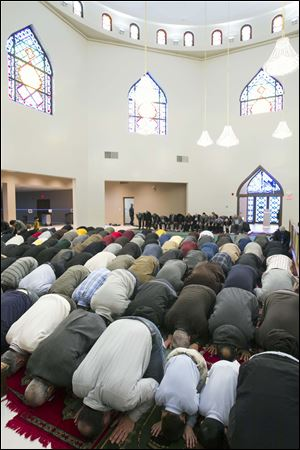 Members of the congregation pray during a Friday prayer service at the Islamic Center of Greater Toledo.