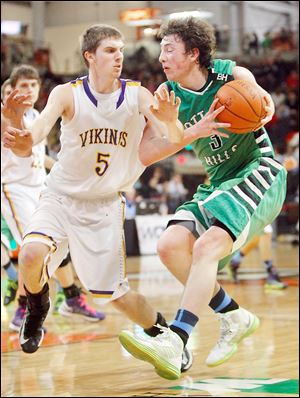 Geoff Beans, who led Ottawa Hills with 19 points, runs into the defense of Leipsic's Derek Steffan in a Division IV regional final at BGSU.