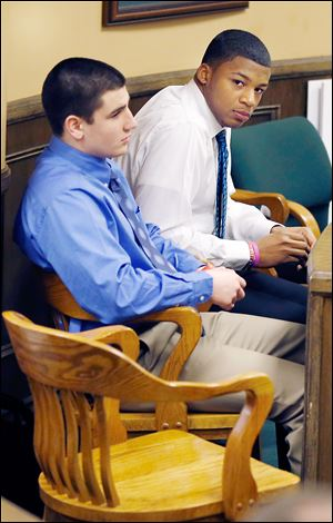 Trent Mays, 17, left, and co-defendant Malik Richmond, 16, sit in court before the start of the third day of their trial on rape charges at the Jefferson County Justice Center in Steubenville, Ohio, on Friday.