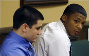 Trent Mays, 17, left, and co-defendant 16-year-old Ma'lik Richmond sit in court before the start of the third day of their trial on rape charges in juvenile court today in Steubenville, Ohio.