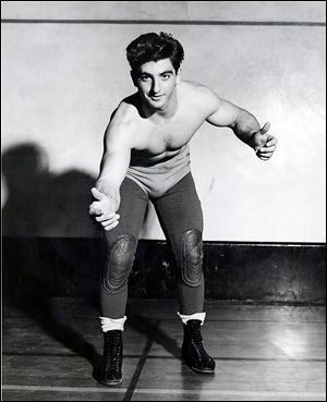 Dick Torio, in a wrestling pose in this 1950s-era photo, moved to Toledo in 1949. He placed fifth in the Mr. World competition in Philadelphia in 1951.