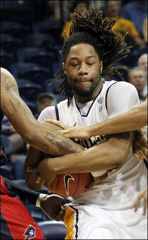 UT's Reese Holiday rips down a rebound.