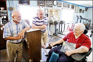 Joe Scalzo, left, and Buddy Carr, center, visit with Dick Torio at his Torio Health Club in 2012. Mr. Torio has sold his building and will hold a farewell open house today. Almost more important than a gym, Torio's Health Club was a place for men to find camaraderie.