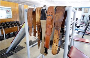 Weight belts were part of the workout equipment, along with weights and machines at Torio Health Club. The once- state-of-the-art facility remained a spartan old-school gym until its closing.