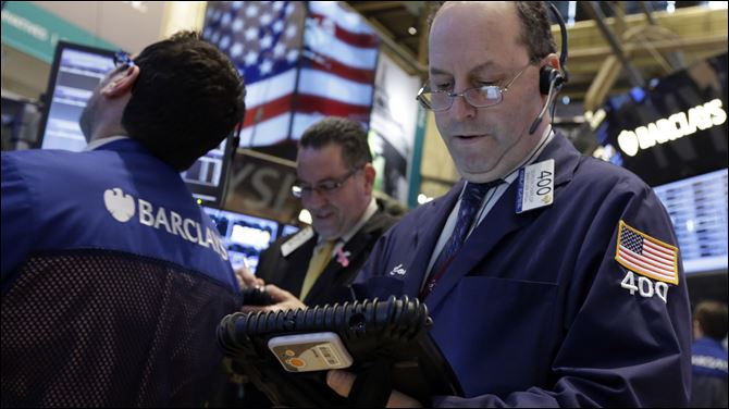 Trader Gordon Charlop, right, works on the floor of the New York Stock Exchange. World stock markets shared Wall Street's ebullience and turned higher Thursday March 14, 2013 ahead of the release of U.S. jobless claims.