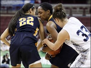 Notre Dame's Jayda Worthy (22) and Kaayla McIntyre (15) battle Kettering Fairmont's Kathryn Westbeld (33) for the ball.