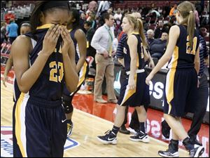 Notre Dame's Christiana Jefferson (23) reacts after losing to Kettering Fairmont 37-31.