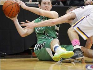 Ottawa Hills High School player Ben Silverman, 4, tries to pass the ball as Leipsic High School player Aric Schroeder ,24, defends.