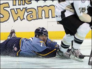 Toledo Walleye player Joey Martin, 14, dives after the puck.